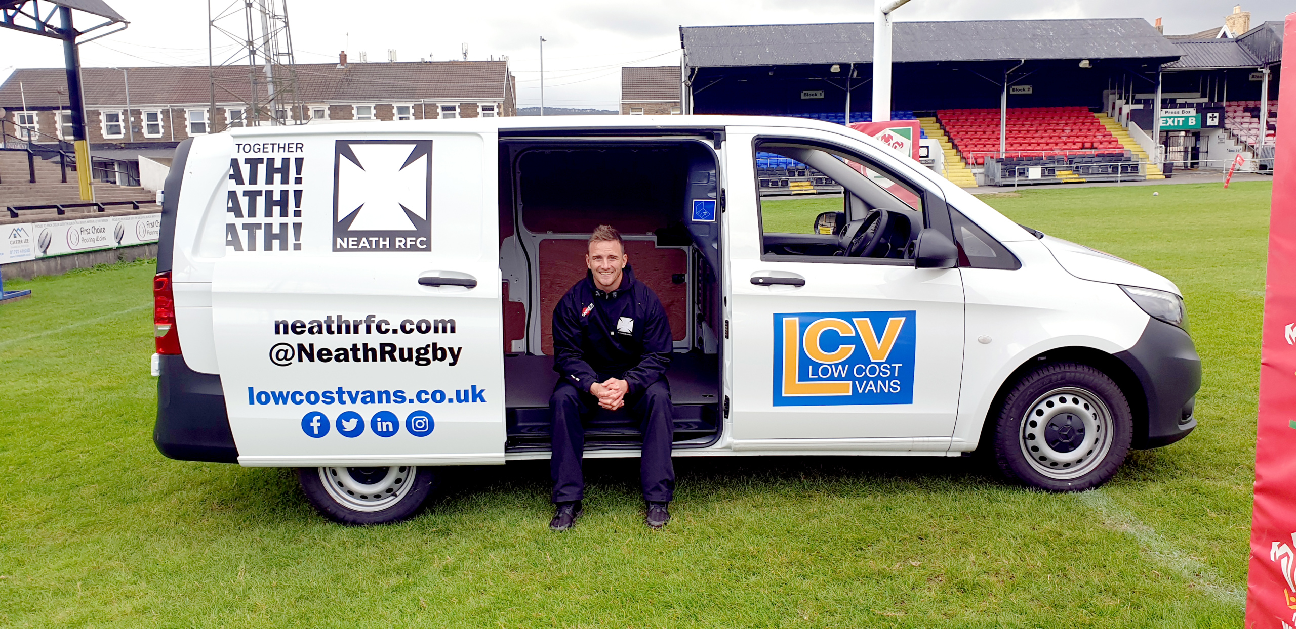 Neath RFC captain Aaron Bramwell sitting in the Low Cost Vans supported van