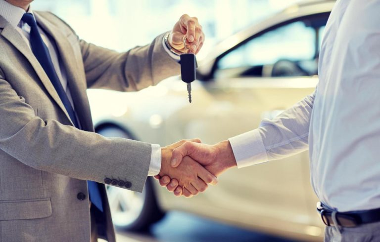 Handing over car keys to new lease car
