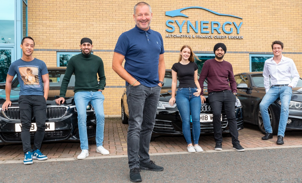 Paul Parkinson and members of Synergy staff now that it has been sold to Newable