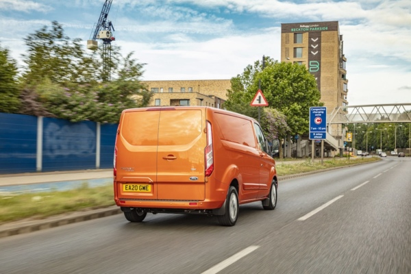 Ford Transit Custom PHEV rear three quarters approaching congestion charging zone