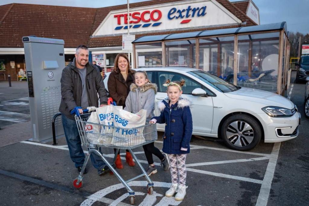Happy shoppers charging up at Tesco 1200px