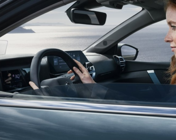 Woman at the wheel of a personal contract hire citroen