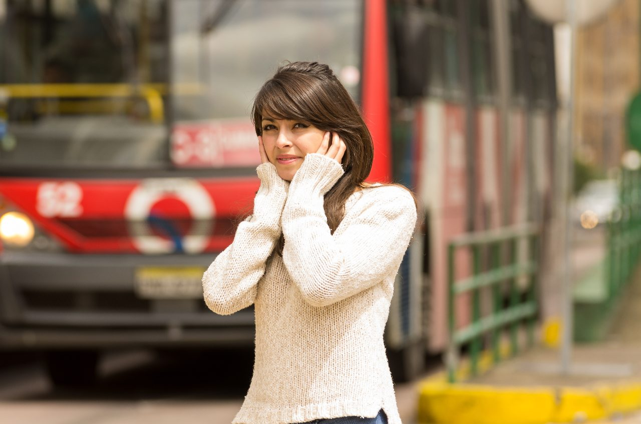 woman suffering the effects of TRAFFIC noise pollution