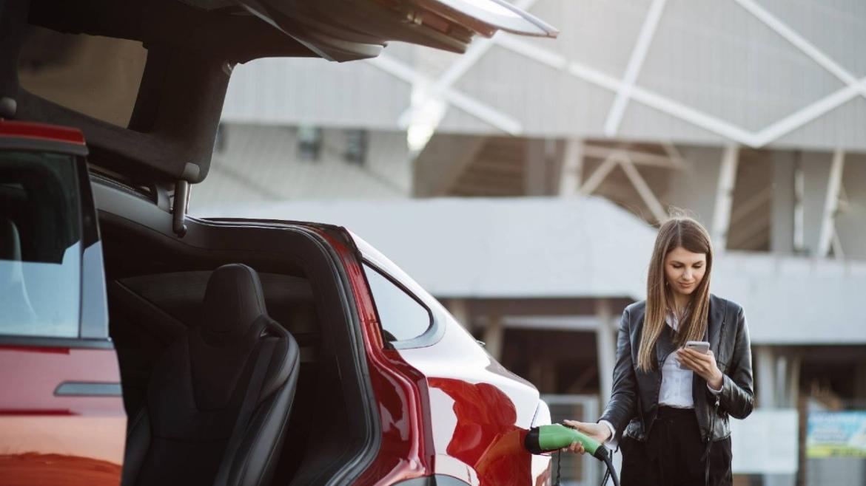 Female driver charging her Tesla on a Fleet Alliance salary sacrifice scheme 1280px