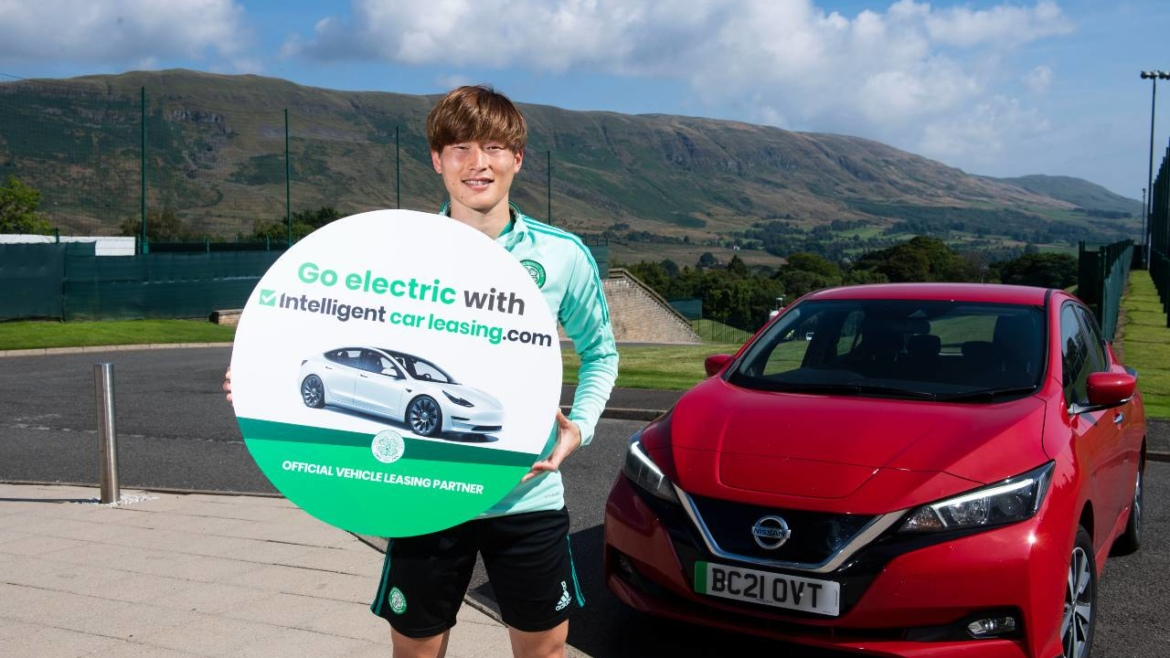 Kyogo Furuhasi with one of the Nissan Leaf vehicles from Intelligent Car Leasing